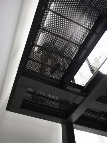 NYU Institute for the Study of the Ancient World - New York - Interior photo looking up at mesh walkway - Selldorf Architects